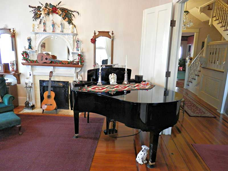 Piano in Living Room | Americus Garden Inn Bed & Breakfast, Georgia